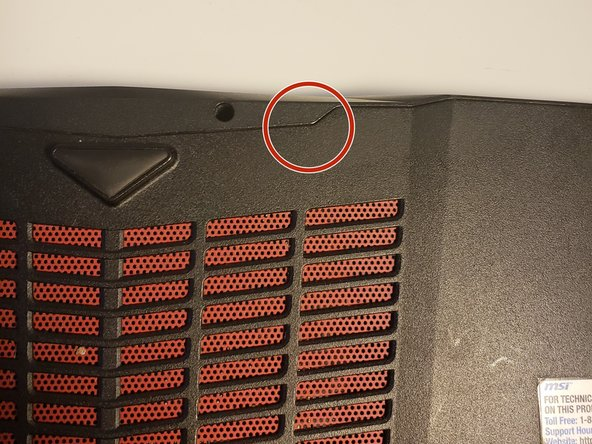 Insert a plastic opening tool into the seam of the back cover