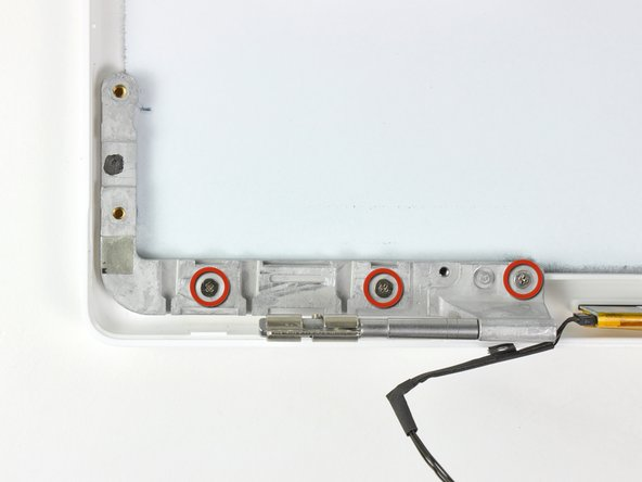 Remove the three 3.2 mm Phillips screws securing the left clutch hinge to the rear display bezel.