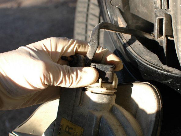 Unplug the wiring harness from the bulb socket connection.