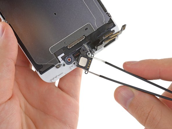 Use a pair of tweezers to firmly grasp and remove the earpiece speaker from the display assembly.