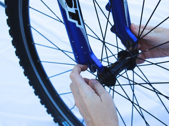 Pull the frame of the bike upwards to separate the front wheel.