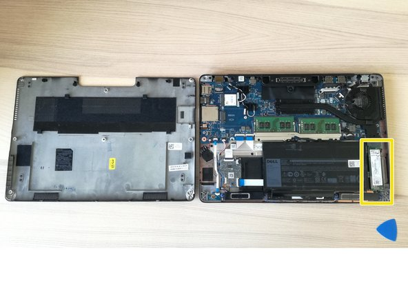 After removing the cover, the SSD slot is on the bottom right, right next to the battery.