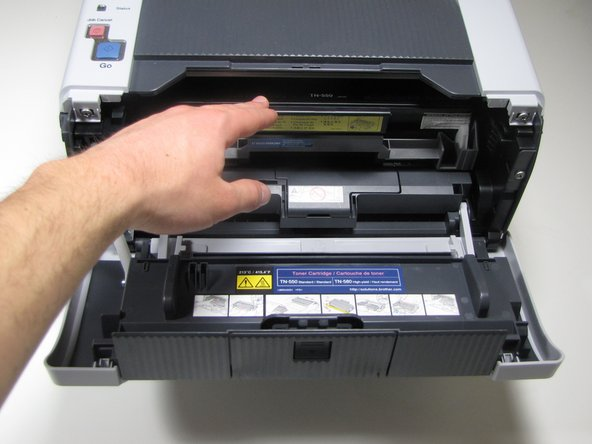 With the front cover in the downward position, the drum & toner unit will be visible.