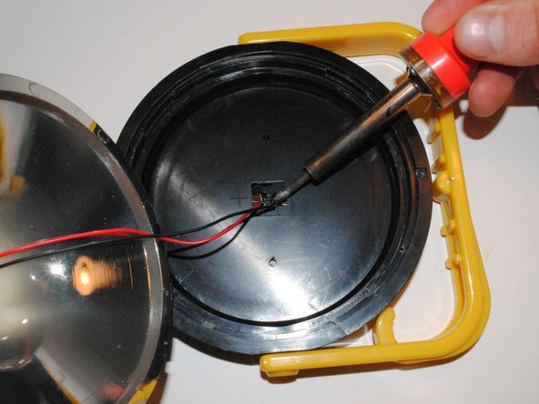 Feed the two disconnected wires from the white clip back up through the main shaft of the globe to the top portion of the lantern where the lid attaches.