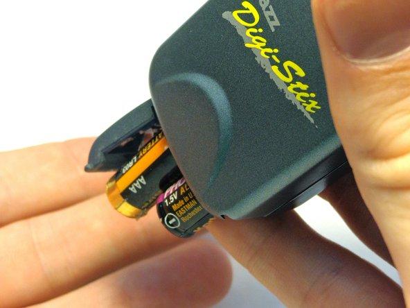 Tilt device so that batteries slide out.