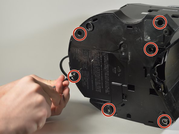 Using the Phillips #1 screwdriver, remove the six 140mm screws from the bottom of the Keurig machine.