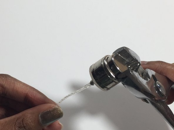 Using the pliers, gently twist the jammed nozzle in a clockwise motion until the pump pops up.