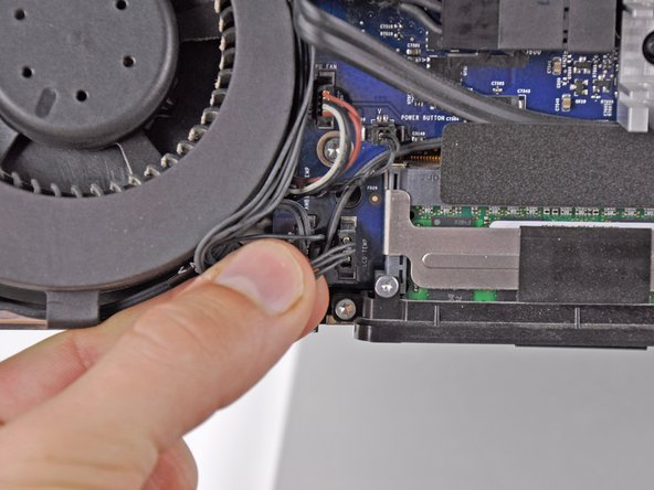 Disconnect the LCD temperature sensor by pulling the connector straight out of its socket on the logic board.