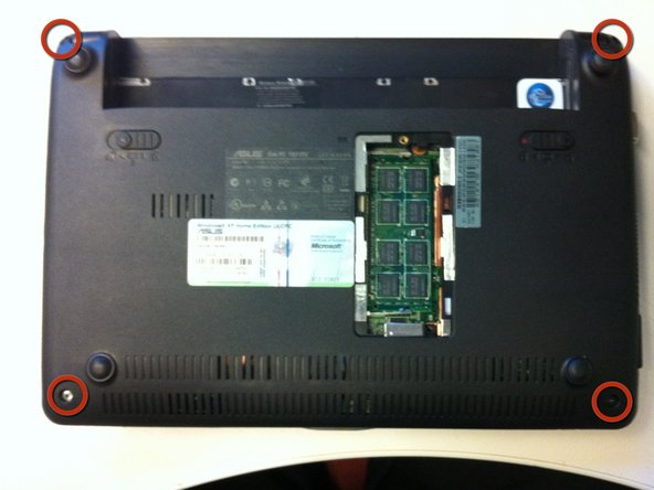 Remove the remaining four screws from the corners of the netbook.