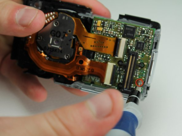 Remove the small screw holding down the lower motherboard(#00P, 3.2mm).