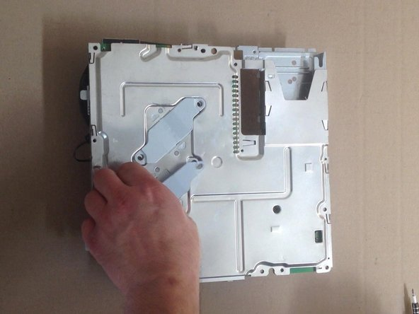 Remove the two heat sink clamps and bottom shield, then gently separate  the motherboard off the top shield.