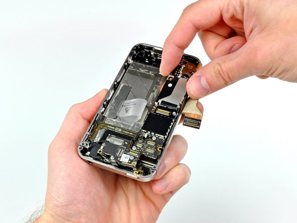 The logic board can finally be lifted out of the iPhone.