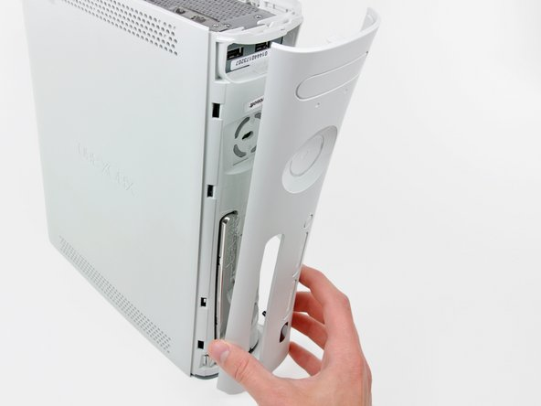 Remove the faceplate from the front face of the console.