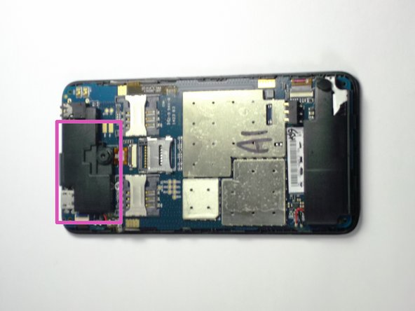 Insert the plastic opening tool between the black pad and the circuit board. Then gently pry off the black pad.