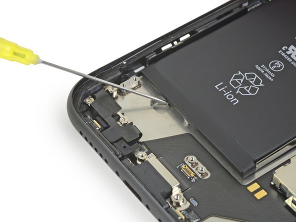 If any of the adhesive strips broke off and the battery remains stuck to the rear case, remove it by adding a few drops of isopropyl alcohol (90% or greater) underneath the battery near the stuck strip(s).