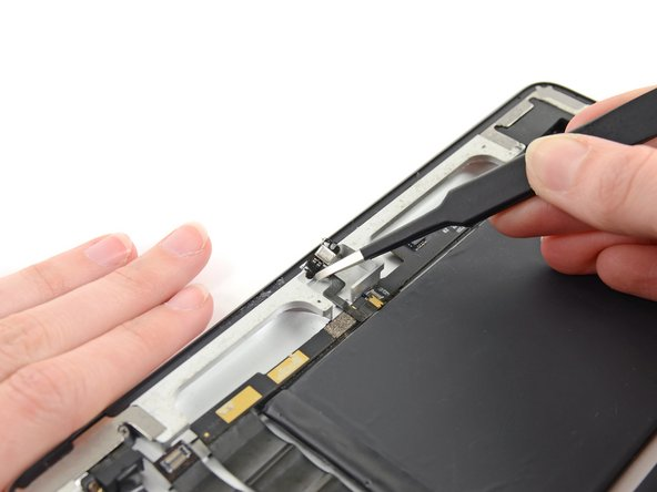 Remove the microphone cable from the rear case.