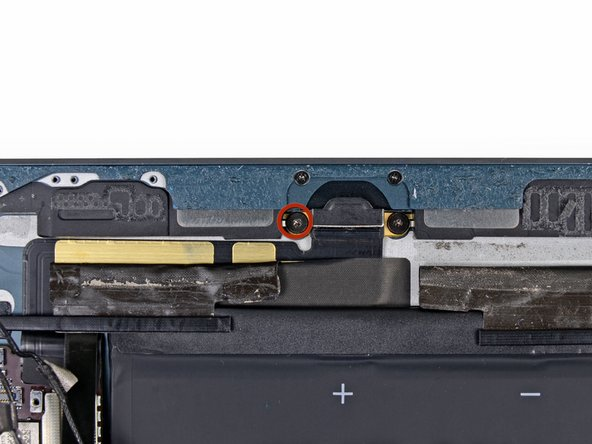 Remove the single 1.4 mm Phillips #00 screw securing the right speaker to the rear case.