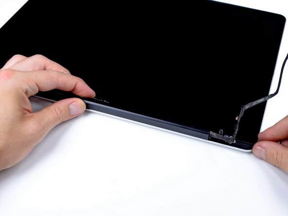 Grab the clutch cover as shown and slide it toward the right side of the display.