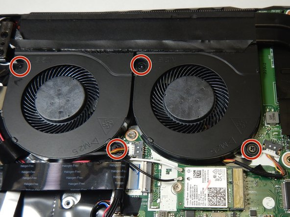 Use the Phillips #0 screwdriver to remove the four 9 mm screws holding the fan assembly in place.