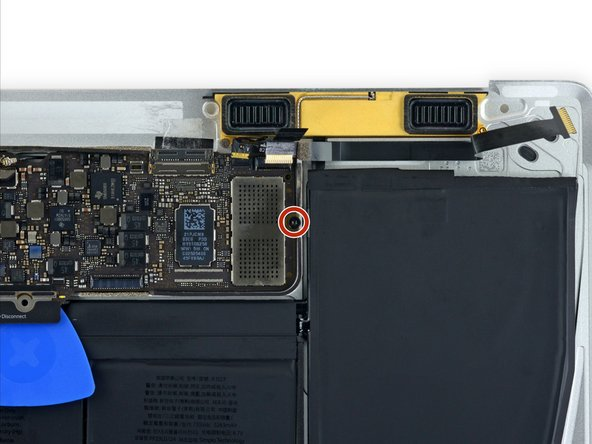 Remove the single 3.5 mm T5 Torx screw securing the logic board to the lower case.