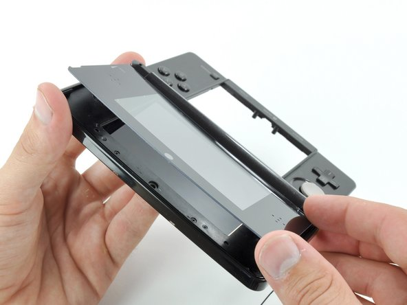 With all of the sides free, lift the upper display front panel off the display bezel.