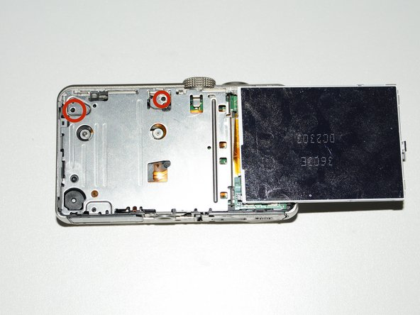 Remove the two 4.2 mm screws in order to remove the inner cover located beneath the screen.