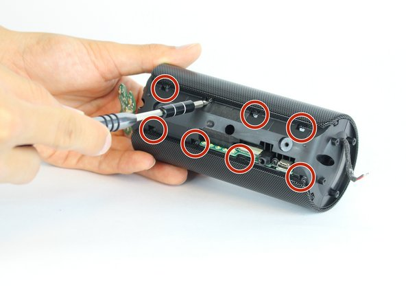 Using a flat-head  screwdriver or spudger, pry out the 8 metal nibs on the back side of the speaker.
