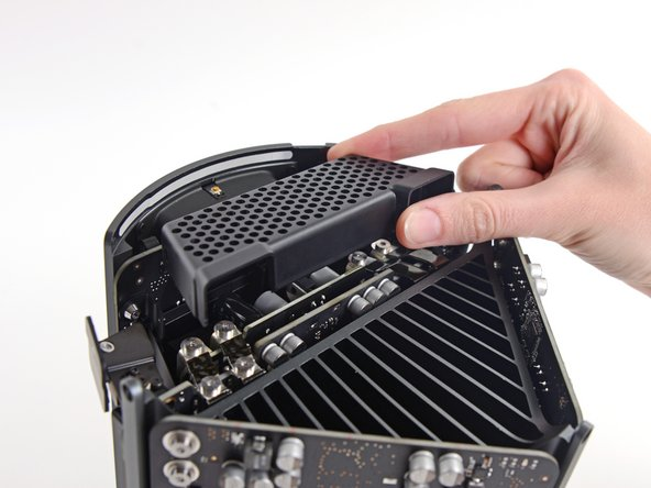 Remove the power supply cage from the top of the power supply.