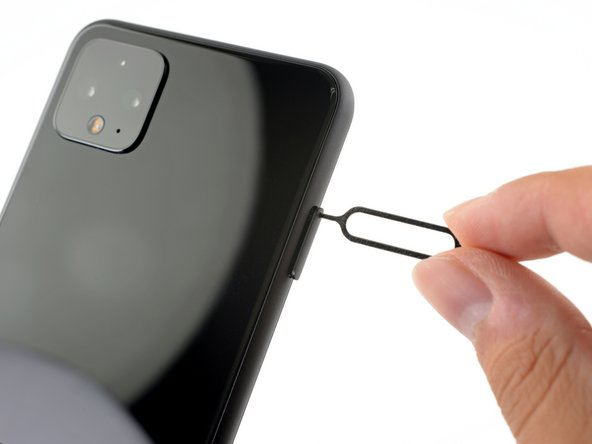 Insert a SIM eject tool, bit, or a straightened paper clip into the small hole on the SIM card tray on the left edge of the phone.