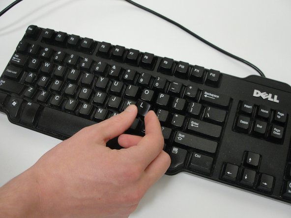 Push in the clean keys until you hear a popping sound.