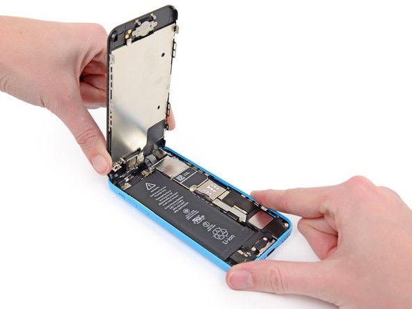 Lift the home button end of the front panel up to gain access to the connectors near the top of the phone.