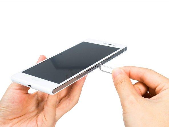 Remove SIM card trays.