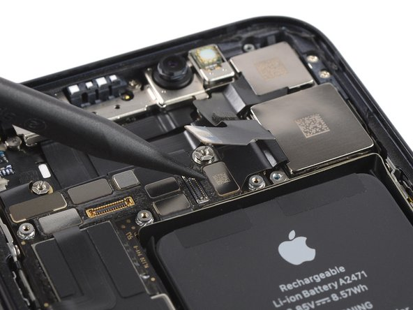 Use a spudger to disconnect the wide camera flex cable by prying it straight up from its socket.