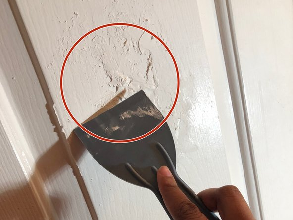 Remove any excess body filler with putty knife
