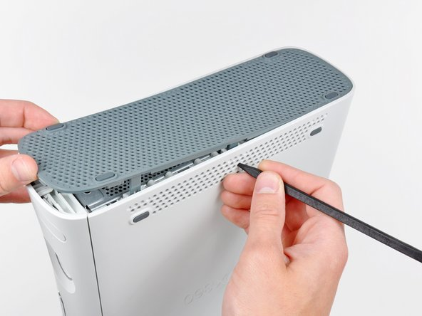 Repeat the same process to release the two center clips on the bottom vent.