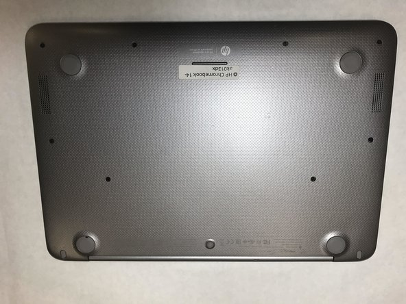Turn the Chromebook upside down, as shown in the first image.