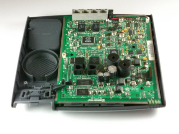 Lift up the motherboard out of its housing in the front cover of the phone.