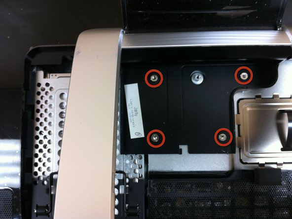Remove 4 Phillips head screws and lift metal plate covering hard drive
