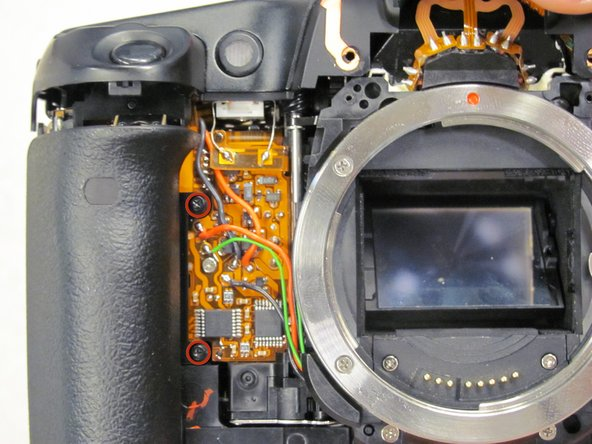Remove the two 5.5 mm screws from front of camera.
