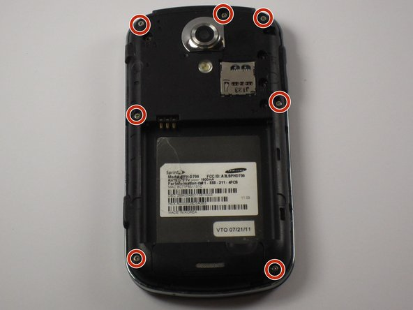 Remove the seven screws from the back of the phone using the Phillips #000 screwdriver.