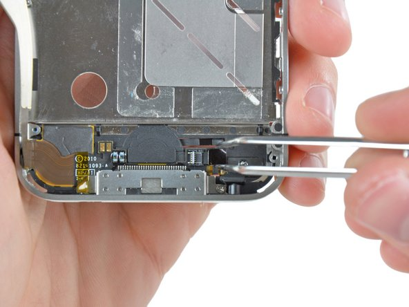 Use a pair of tweezers to pull the home button ribbon cable out of its socket.