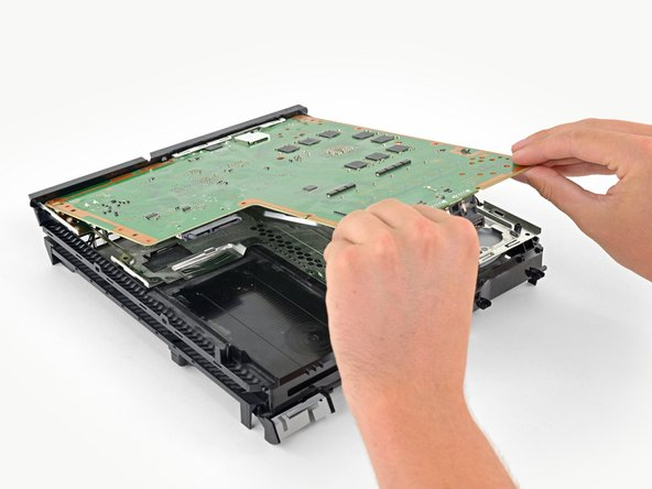 Lift the motherboard out from the PS4.