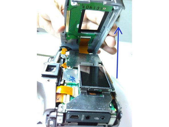 Carefully lift the back casing from the camera's body from left to right.