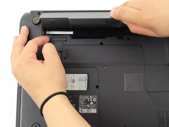Slide the horizontal latch to the right to pop open the battery pack.