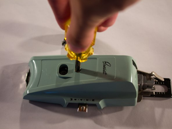 Using the phillips screwdriver, unscrew the cover screw.