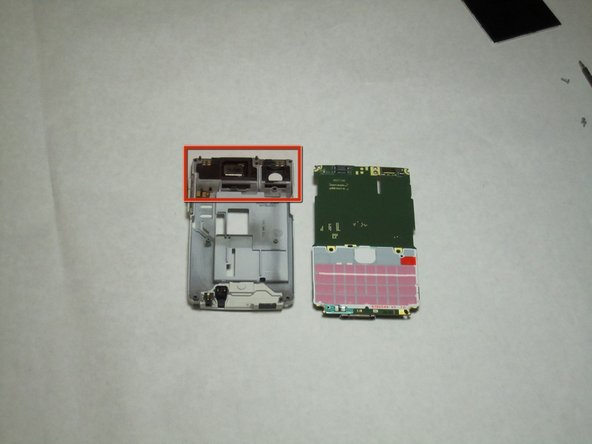 After the logic board has been removed, there is nothing else securing the antenna to the back cover. Simply remove the antenna by pushing outward from the interior side.