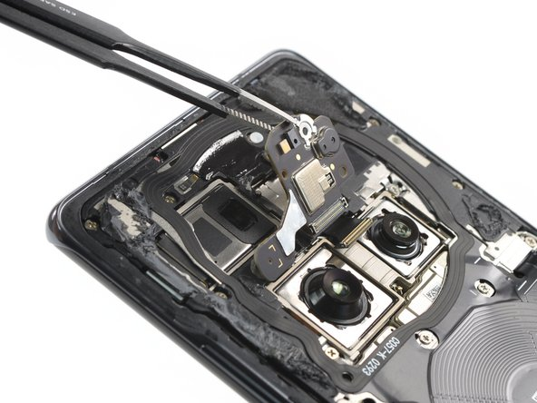 The first component to come loose is not the motherboard shield or charging coil, but the flash sensor assembly.
