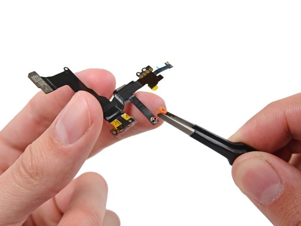 Remove any plastic coverings from the microphone on the sensor cable assembly.