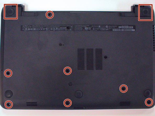 Flip the laptop over to view the bottom and remove the remaining screws from the bottom.