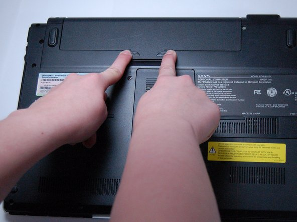 Slide the two latches towards the center of the laptop in order to release the battery.
